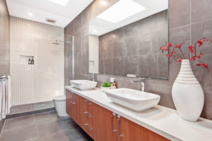 A modern bathroom with water-saving sanitary ware i.e. taps, shower head and toilet system. Design by Complex Constructions, Victoria 3939